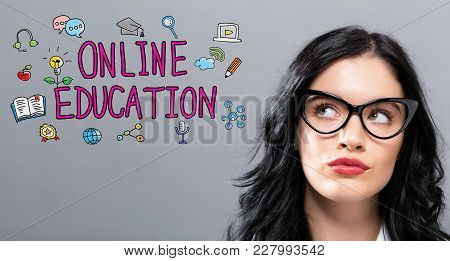 Online Education With Young Businesswoman In A Thoughtful Face