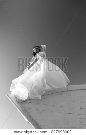 Woman In White Dress On Boat. Girl In Dress On Blue Sky. Bride And Wedding Ceremony. Wedding Fashion