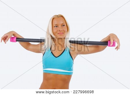 Blond Female In Sportswear Isolated On A White Background.