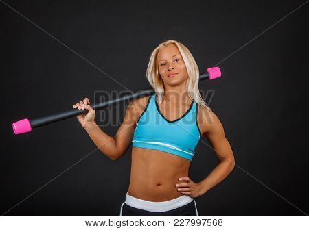 Blond Fitness Woman Doing Exercises With Expander.
