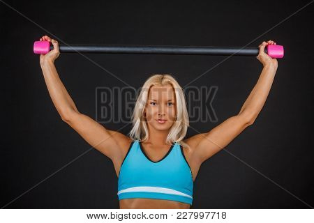 Sporty Blond Fitness Woman Doing Exercises With Expander.