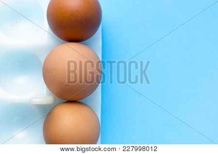 Three Eggs On A Blue Background. The Concept Third Wheel.