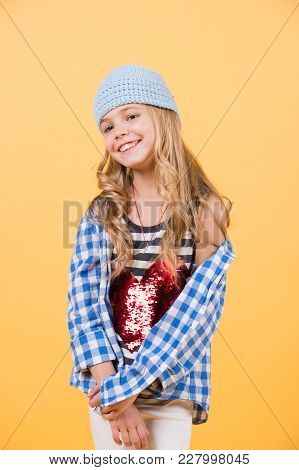 Happy Smiling Six Year Old Girl Wear Shirt With Big Red Heart On Orange Background.