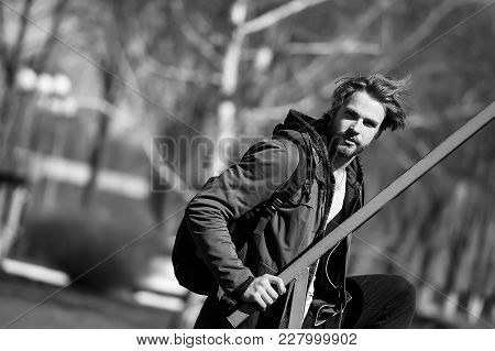 Sexy Bearded Man Or Handsome Guy In Brown Hoodie Jacket Or Jersey With Sport Bag, Has Stylish Hair S