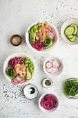 Fresh seafood recipe. Shrimp salmon poke bowl with fresh prawn, brown rice, cucumber, pickled sweet onion, radish, soy beans edamame portioned with black and white sesame. Food concept poke bowl poster