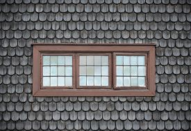 Closed Old Brown Windows On Wooden Tile.
