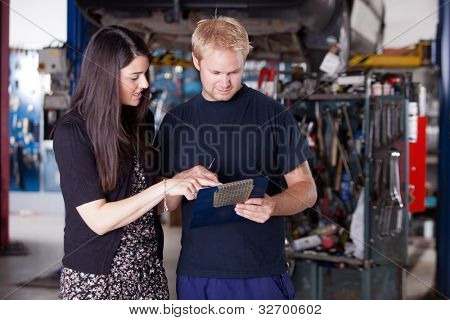 An upset customer disputing a repair report with a mechanic