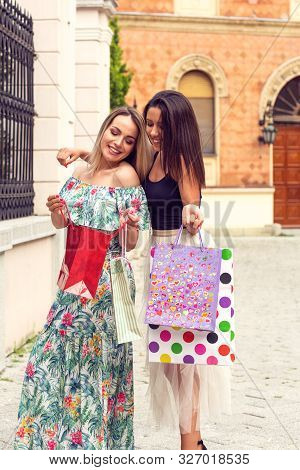 Shopping In Black Friday. Women Shopping. Happy Woman Holding Shopping Bags And Smiling While Standi