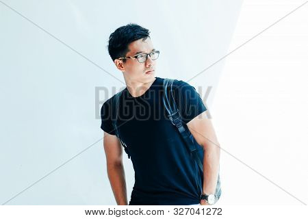 Young Handsome Asian Men Wearing Casual Black Tshirt On White Background In Sai Gon City, Vietnam