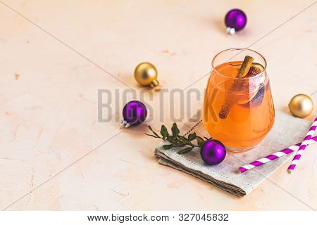 Christmas And New Year Pink Cocktail With Fig And Cinnamon  In Glass On Pink Concrete Background, Cl