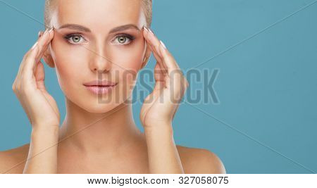 Beauty portrait of healthy and attractive woman. Human face in a concept of spa, skin care, cosmetics, make-up, complexion and face lifting. poster