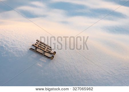 Sleigh On Snow For Greeting Card. Wooden Sleigh On White Snow. Toy Of Sleigh On Snow Hill. Copy Spac