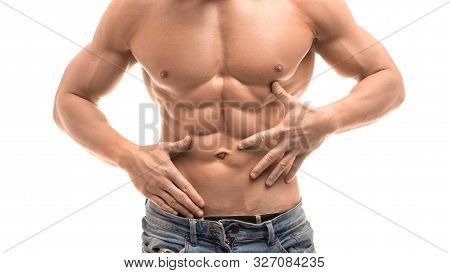 Cropped Image Of A Male Shirtless Torso With Perfect Abs. Sexy Man It Blue Jeans And White Shirt On
