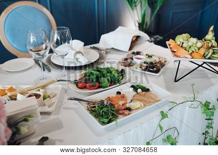Wedding Table With Starters.wedding Table With White Tablecloth Served With Healthy Greens, Cold Fis