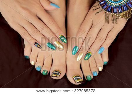 Multicolored Pedicure And Manicure With Rhinestones On Oval Long Female Nails.nail Design With Turqu