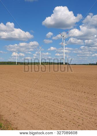 Wind Power Turbines In Agricultural Area East Of Hamburg, Germany