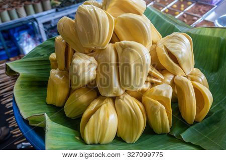 Chon Buri, Thailand - March 16, 2019: Closeup Of Heap Of Peeled Yellow Jack Fruit Displayed On Green