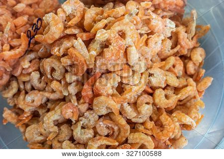 Chon Buri, Thailand - March 16, 2019: Closeup Of Heap Of Dried Small Orange-yellow Shrimp On Display