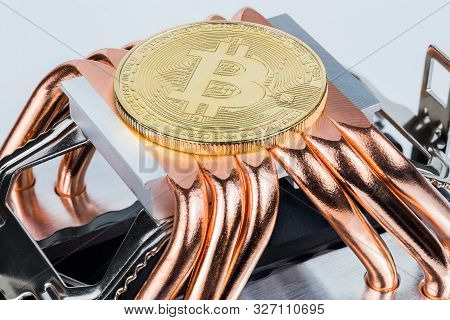 Bitcoin shiner cooling on modern tower heat radiator with six copper heatpipes poster