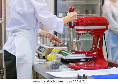 Professional Chef, Baker Workplace With Modern Kitchen Stand Food Mixer On Table At Cuisine Of Resta