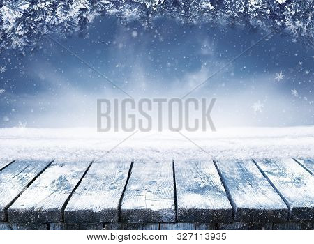 Empty Blue Winter Christmas Scenic Landscape With Copy Space. Wooden Table With Snow And Fir-trees C