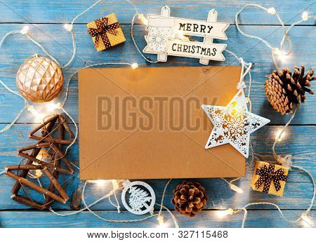New Year Decorations Around Christmas Letter Empty Space For Text Burning Lights Garlands On Blue Wo