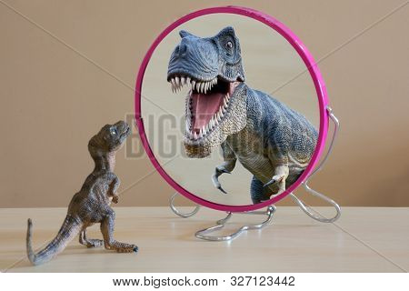 Little Dinosaur With Self Confidence See A Great Dinosaur Looking Itself Into The Mirror.little Dino