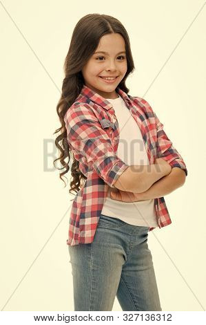 Kid Girl Long Curly Hair Posing Confidently. Girl Curly Hairstyle Smiling Face Feels Confident. Chil