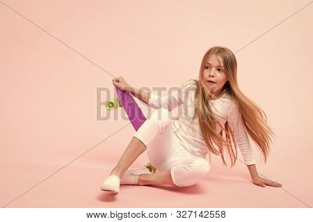 Seeking For Extreme Freedom And Drive. Adorable Extreme Athlete On Pink Background. Little Girl Fall