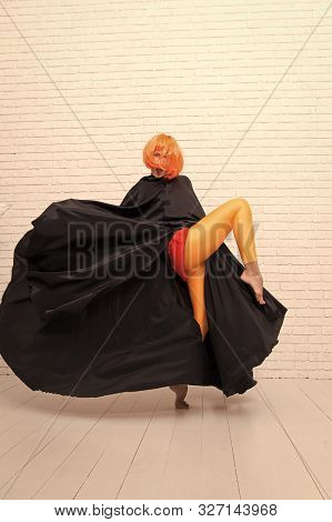 Fancy Look. Sensual Woman Wearing Yellow Hair Wig And Black Toga With Fashion Look. Sexy Look Of Fas