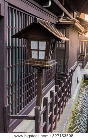A Traditional Japanese Wooden Lantern Located In Front Of The House In Takayama, Japan.
