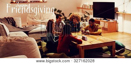 Happy Friendsgiving against millennial adult friends socialising together at home