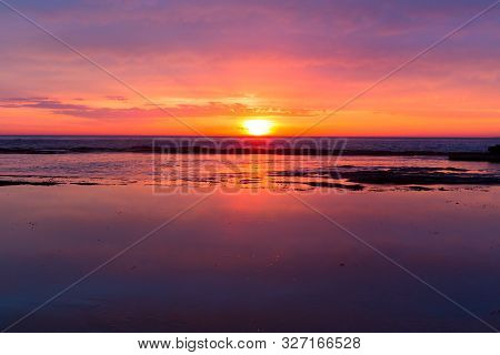 Tranquility Of A Coastal Sunrise As Daybreaks And A New Day Starts. Space For Copy