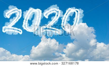 Sunny Sky Cloud Year 2020. Happy New Year Concept. Numbers 2020 Symbol Inscription On Background Of
