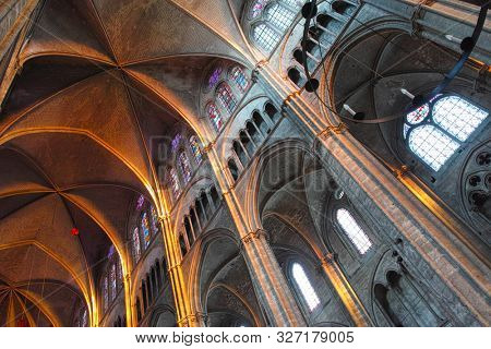 Bourges, Centre-Val de Loire, France - August 04 2018 : The beautiful nave of the cathedral bathed in light