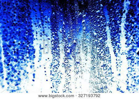 Drops On Glass On A Blue Background. Inversion .texture