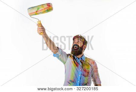 Painter. Professional Painter. Builder Worker. Repair, Building Concept. Handsome Bearded Worker Wit