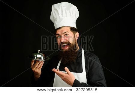 Serving And Presentation. Chef Cook Holds Metallic Dish. Cook Holds Cloche In Restaurant. Cooking. R