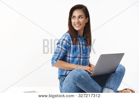 Good-looking Ambitious Female Entrepreneur Computer Programmer Writing Code, Sitting Comfortable Pos