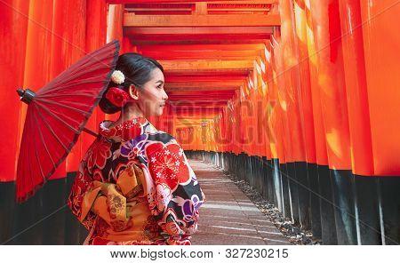 Women In Traditional Japanese Kimonos Walking At Fushimi Inari Shrine In Kyoto, Japan, Kimono Women