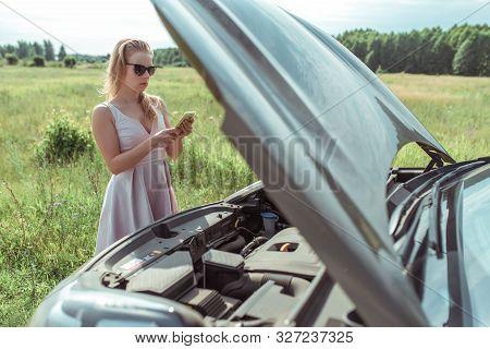 Woman Calls, Writes Reads Message, In Summer Road, Car Broke Down, An Open Hood, An Accident, An Eme