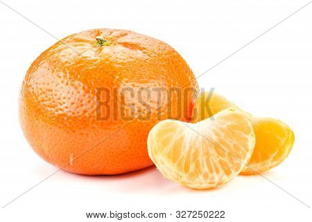 Mandarin Fruit Isolated On A White Background. Next To It Are Slices Of Mandarin