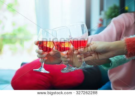 Glasses Of Champagne Close Up, Celebration, Eating And Holidays Concept - Hands Clinking Wine Glasse