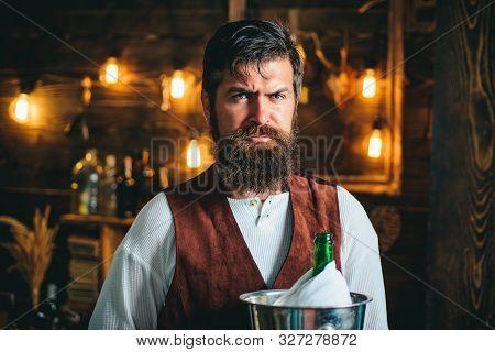 Bearded Bartender Or Waiter In Work Uniform. Long Bearded Waiter Or Servant. Brutal Bearded Servant.