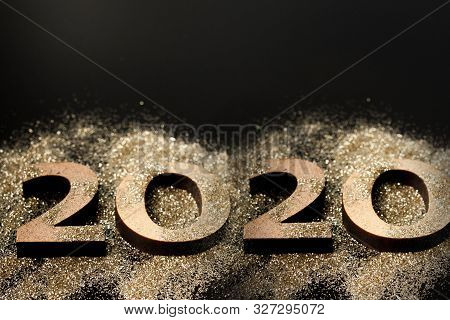 Happy New Year 2020. Creative Collage Of Numbers Two And Zero Made Up The Year 2020. Beautiful Spark