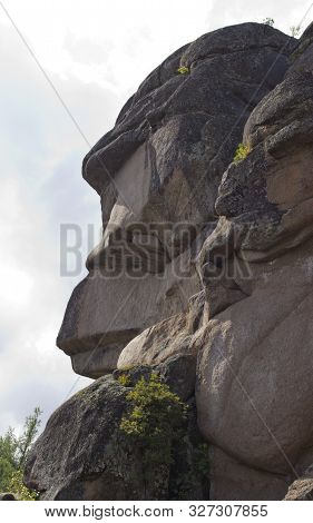 Reserve Krasnoyarsk Pillars. Grandfather Pillar.cliffs And A Forest In The Krasnoyarsk Pillars Natio