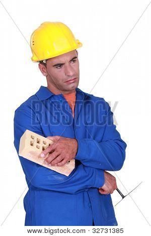 Sad bricklayer