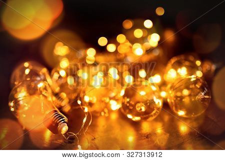 Composite image of brown parquet against fairy lights at home at christmas time