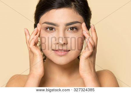 Headshot Of Indian Millennial Girl Touch Healthy Skin