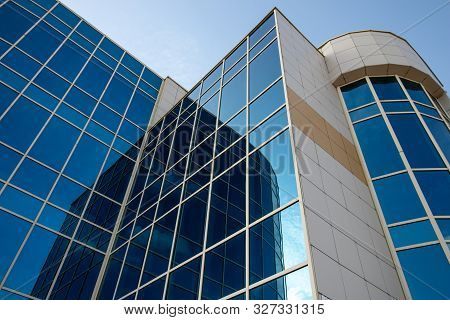 Skyscraper Of Glass, Modern Office Buildings. High-rise Building With Reflection Window. Facade Of B